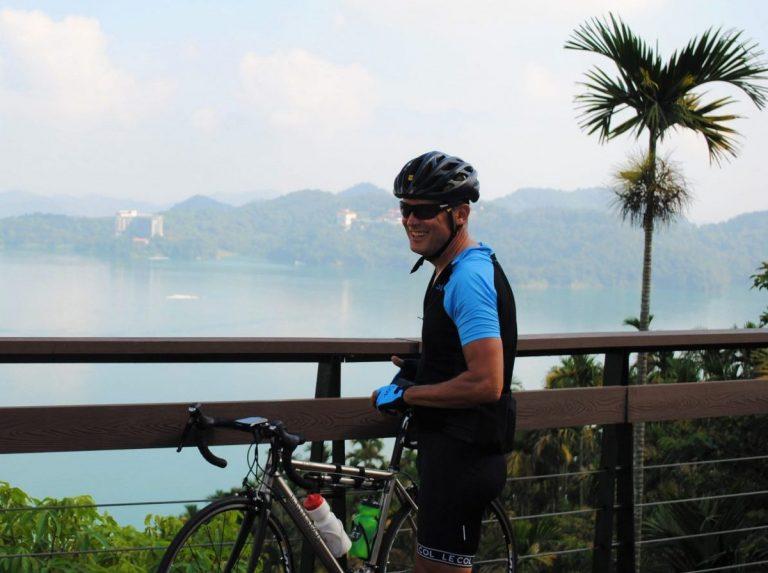cyclist by sun moon lake